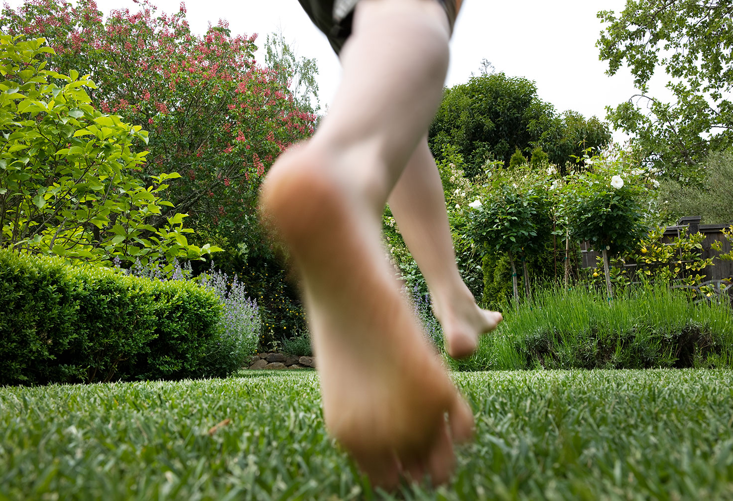 boy-running-in-garden