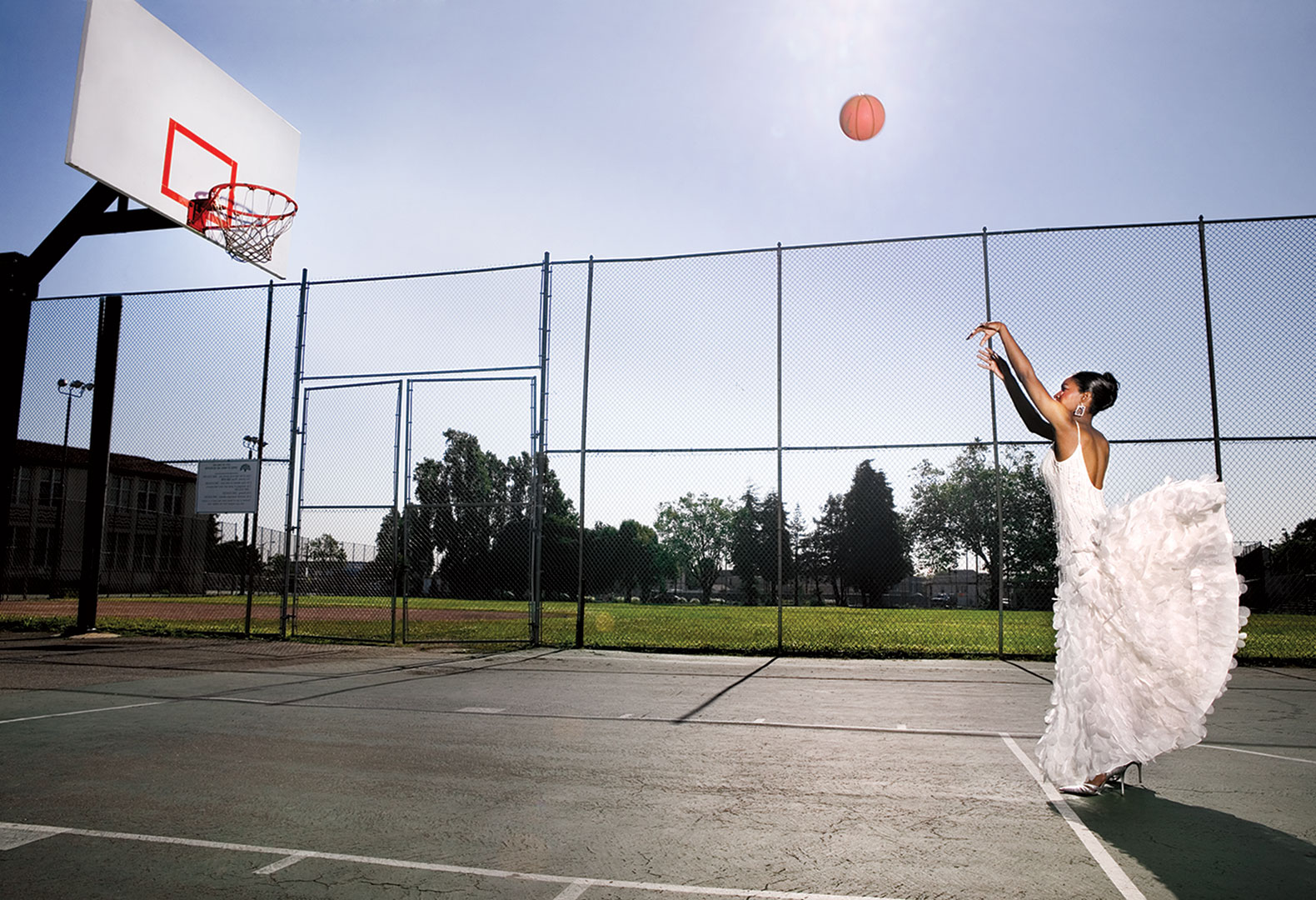 woman play basketball in a dress
