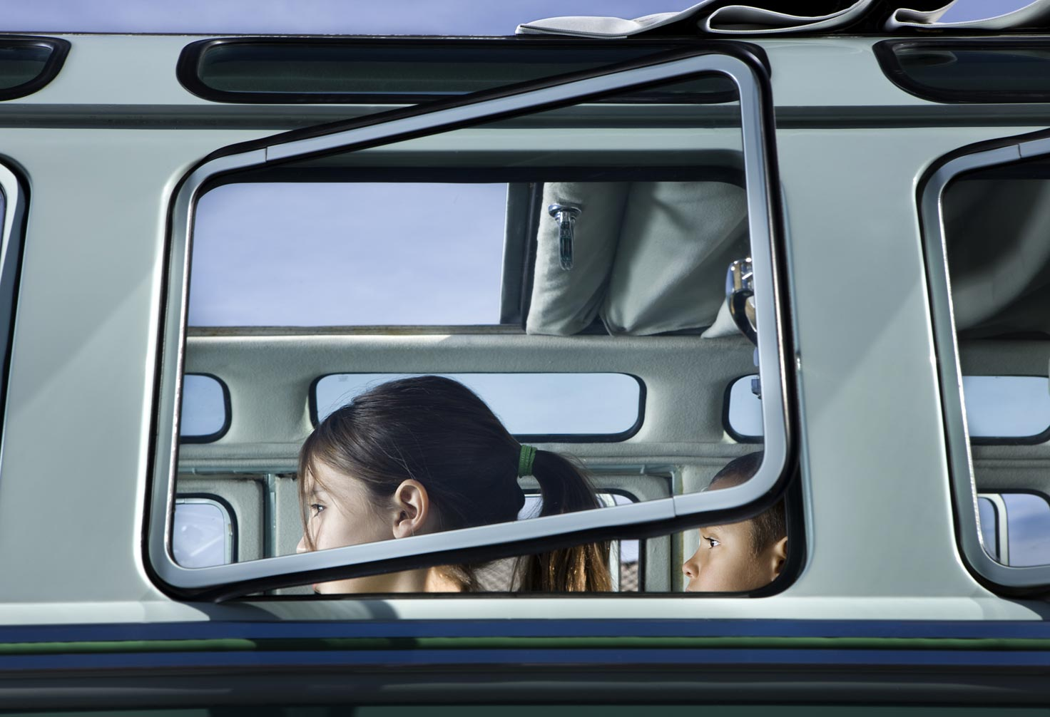 children sitting in car-view from outside windows
